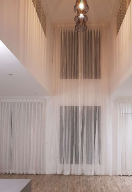 Sheer curtains 2 storey high with roller