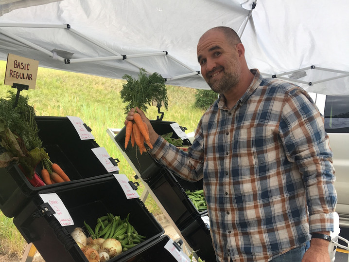 Picking out produce at the Evergreen Local Food Share location