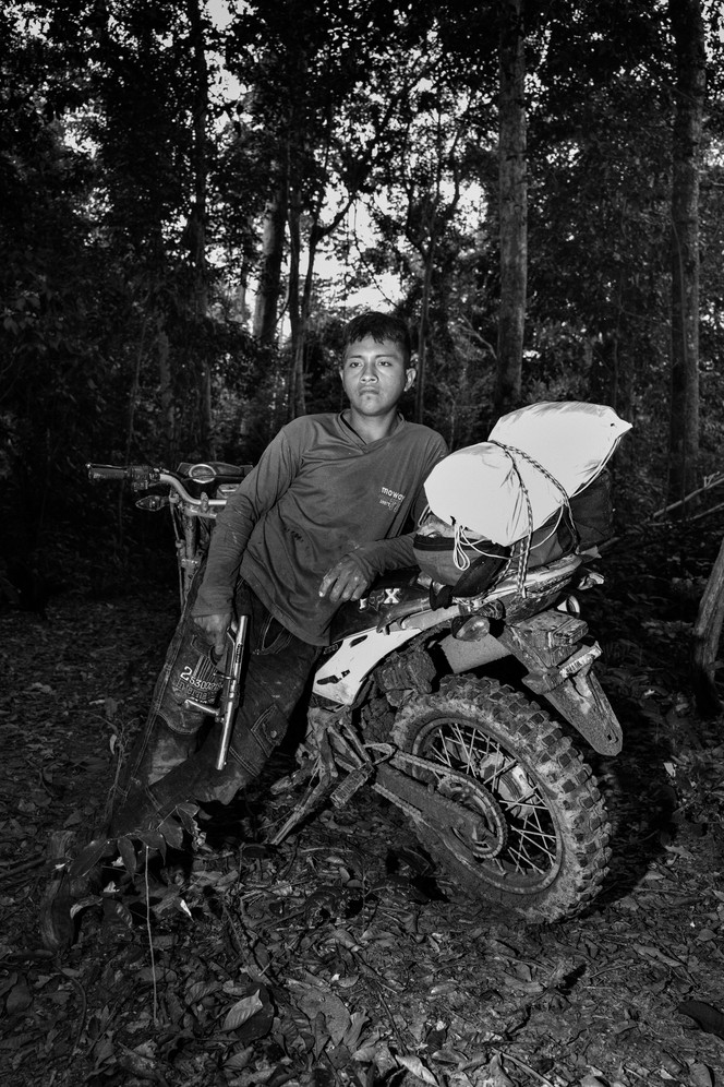 A member of the Guajajara forest guard on patrol at the Araribóia indigenous reserve in Maranhão state. For several towns in the surrounding region, the local economy is based largely on illegal timber and irregular sawmills provide jobs for poor, unskilled workers. Indigenous activists who confront logging interests routinely suffer harassment, threats and even murder.