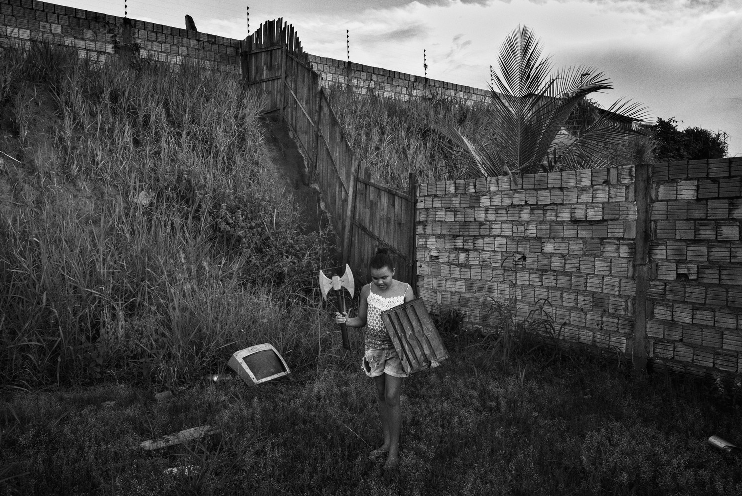 A girl plays in the Jatobá neighbourhood in Altamira, Pará state. Most of the residents here are Ribeirinhos – Amazon River People - who were relocated from along the banks of Xingu River or from other areas of the city that flooded following the inauguration of the Belo Monte Hydroelectric Dam. The housing was provided by the dam's operator Norte Energia. Many residents complain that they have struggled to adapt to such a dramatic change in lifestyle. In 2015, Altamira was considered the most violent city in Brazil and Jatobá was one of the worst affected neighbourhoods.