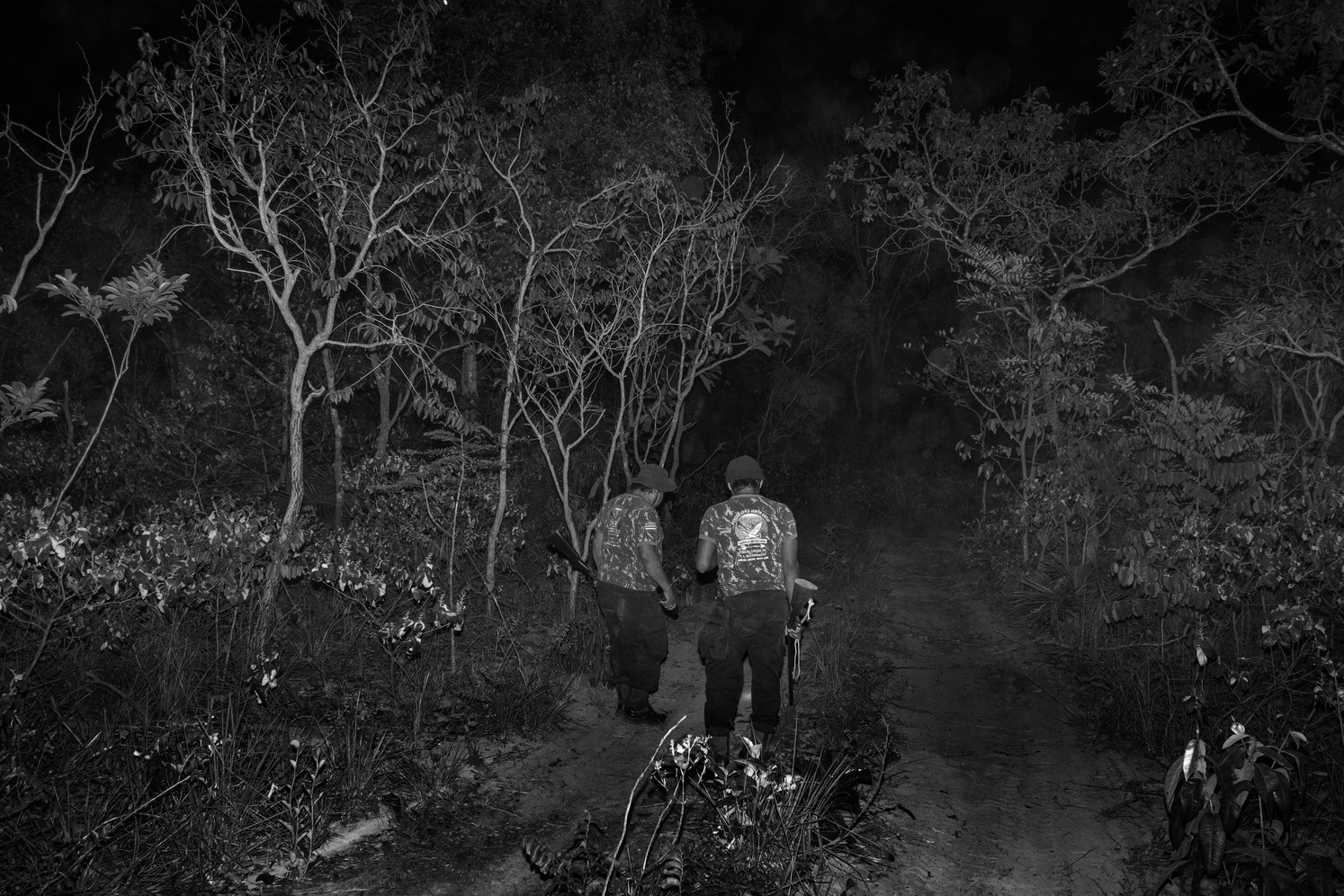 """Two """"guardians of the forest"""" tribemen from the Governador indigenous land are seen during a night patrol looking for trails of illegal loggers."""