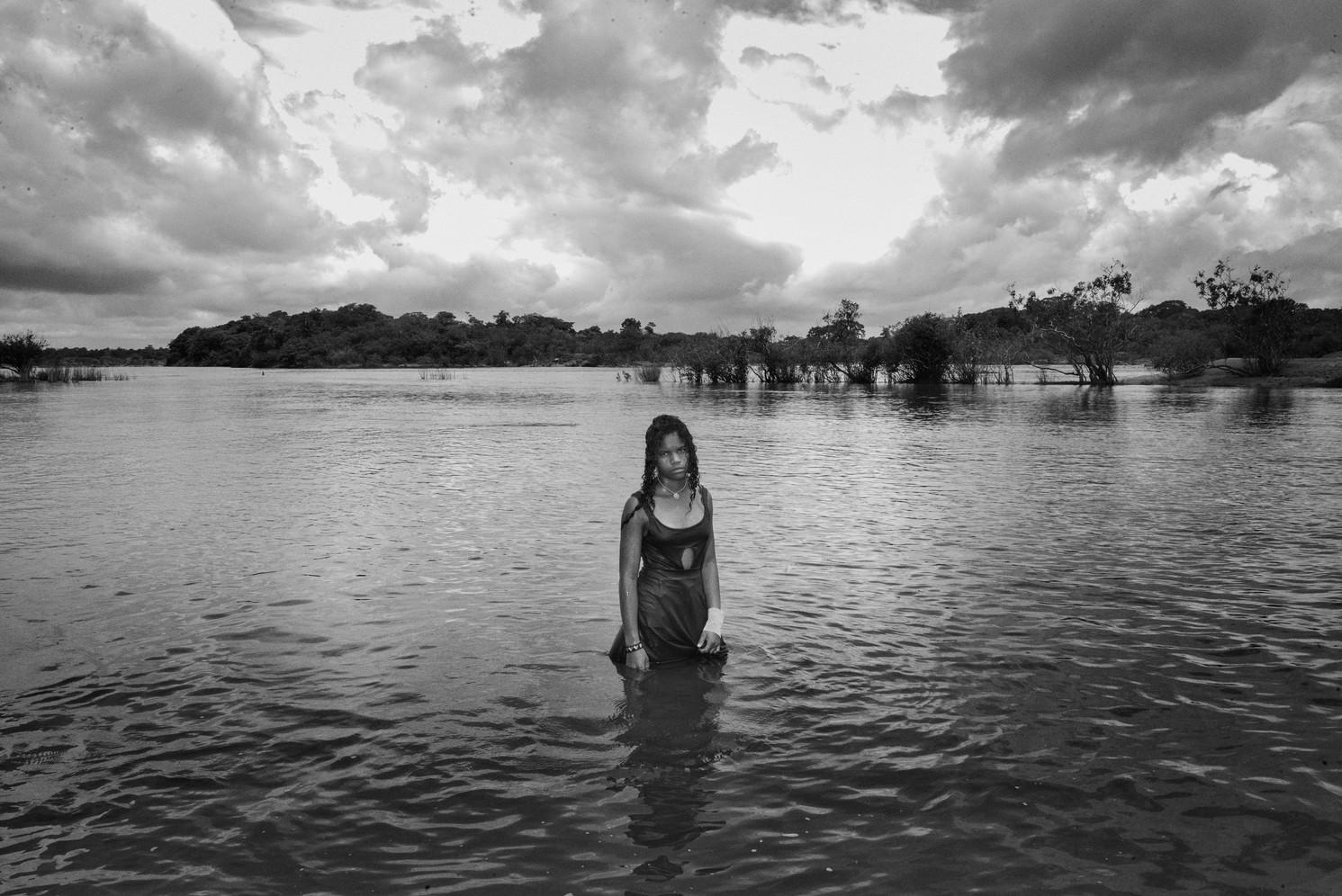 A girl from the Juruna indigenous tribe stands for a portrait in the Xingu river in the Mïratu village, Altamira. The nearby Belo Monte Hydroelectric dam was inaugurated in 2016. Since then, Juruna tribal leaders complain that the flow of the Xingu River has changed. As a result, the river's drier periods are increasingly common. This means that there are less fish for them to eat and that it's more difficult to travel to the city by boat.