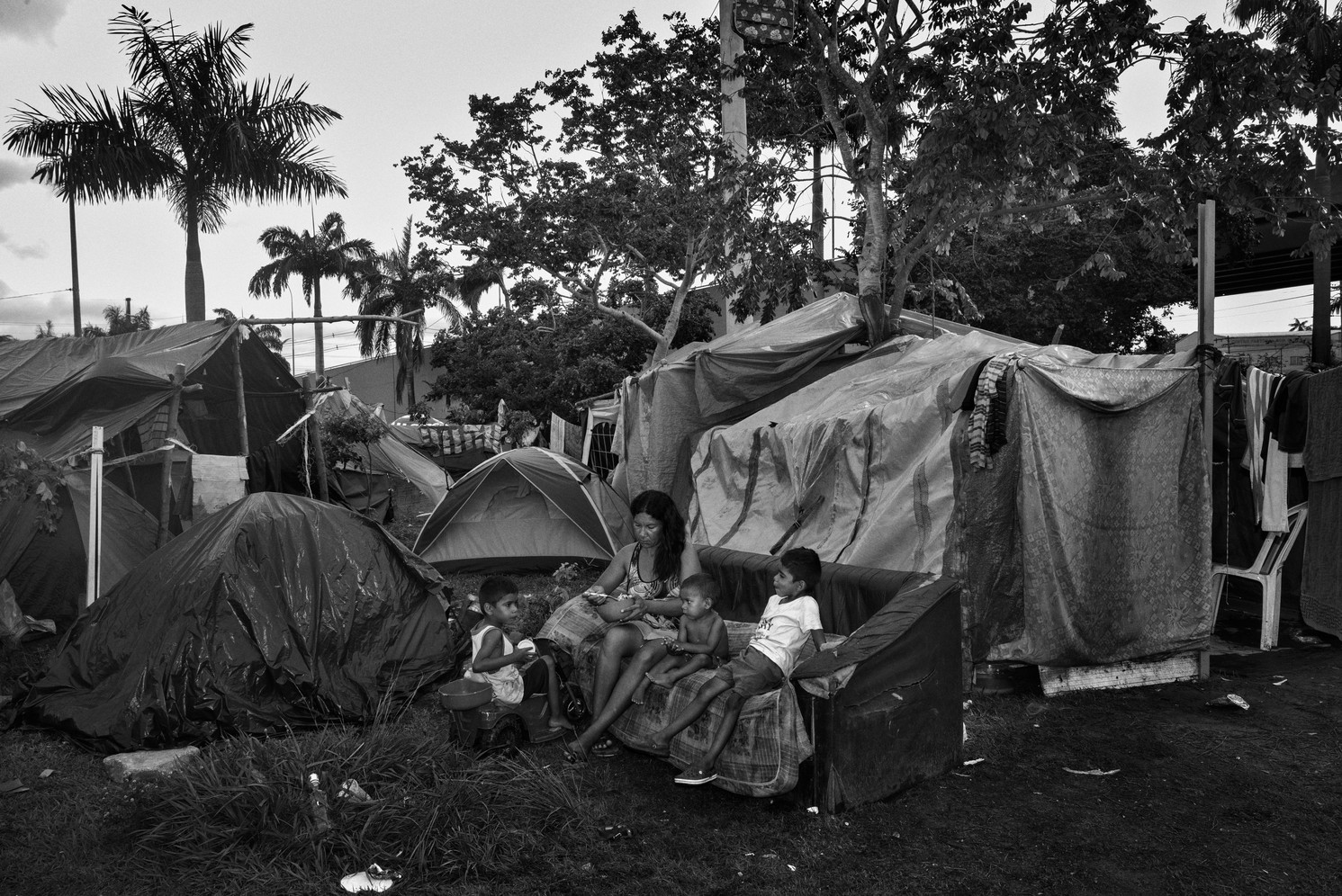 A family of Venezuelan migrants at a homeless encampment in Manaus next to the city bus station. Thousands of n migrants have sought refuge in Manaus in recent years. The city is nearly 1000km distance from the border with Venezuela a journey which many migrants make on foot. Arriving in Manaus, they suffer with unemployment and housing.