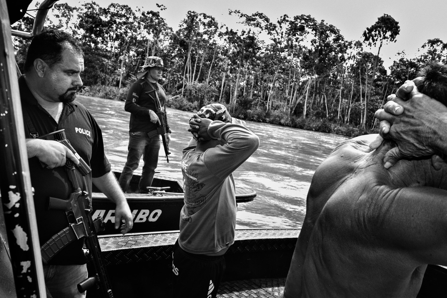 Police from Amazonas state drug squad stop a boat while on patrol on the Solimões River which in the last decade has become a major trafficking route for cocaine consumed in Brazil and sent abroad to Europe. Much of the illicit cargo arrives in Manaus via small fishing boats. In recent years, dissident members of Colombia's Forças Armadas Revolucionárias (FARC) have started working as mercenaries, protecting cargoes against armed river pirates.