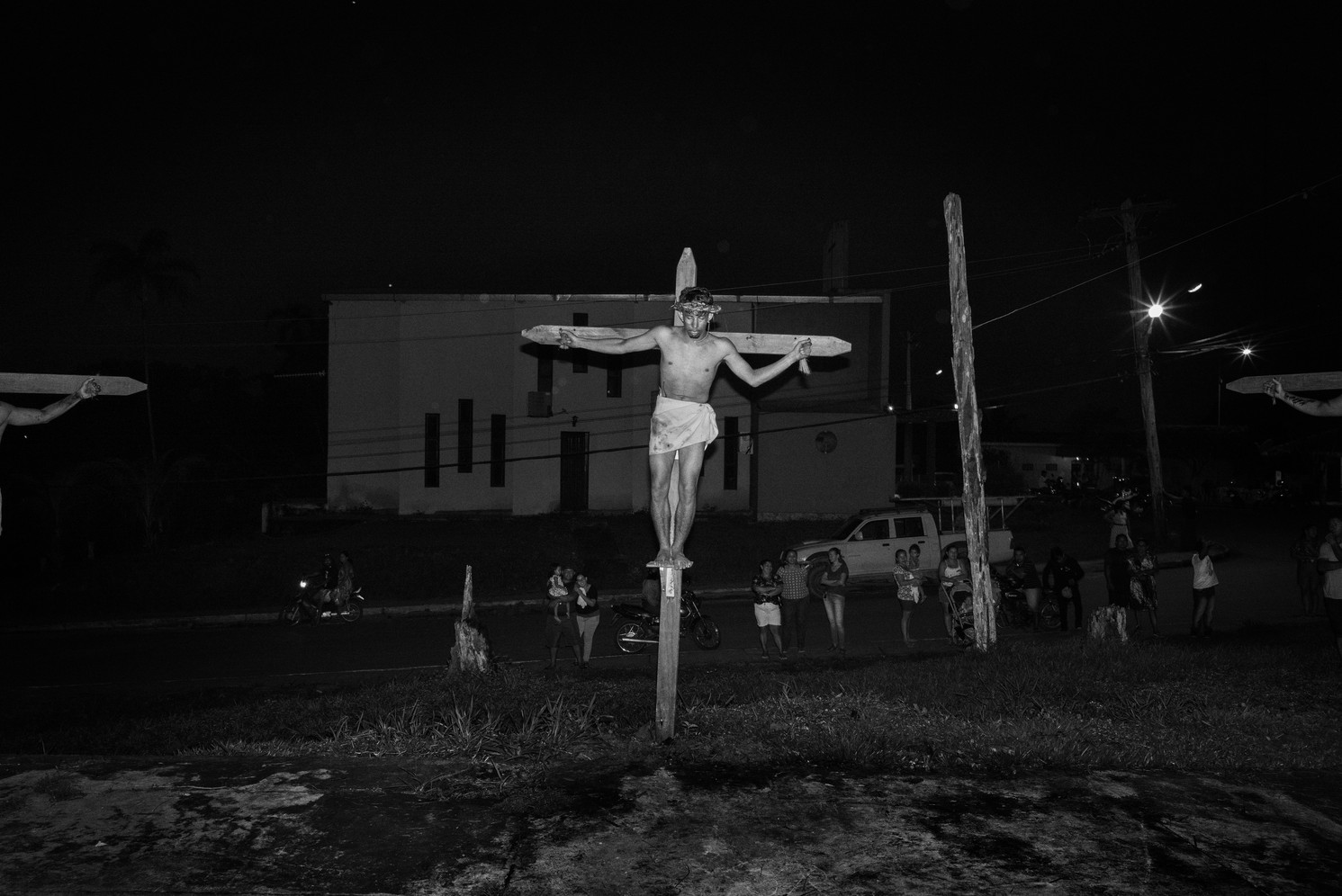 The climactic crucifixion scene of a community Easter nativity play in Careiro Castanho, a small town 100km from Manaus, in Amazonas state, organized by the local Catholic Church. While Brazil remains the world's most populous Catholic nation, it has a significant and fast growing community of Evangelical Christians that today account for about a quarter of the population. In Brazil's Amazon states, Evangelical mega churches with huge congregations are present in urban centres while tiny churches little more than wooden shacks proliferate in isolated river towns only accessible by long boat journeys.
