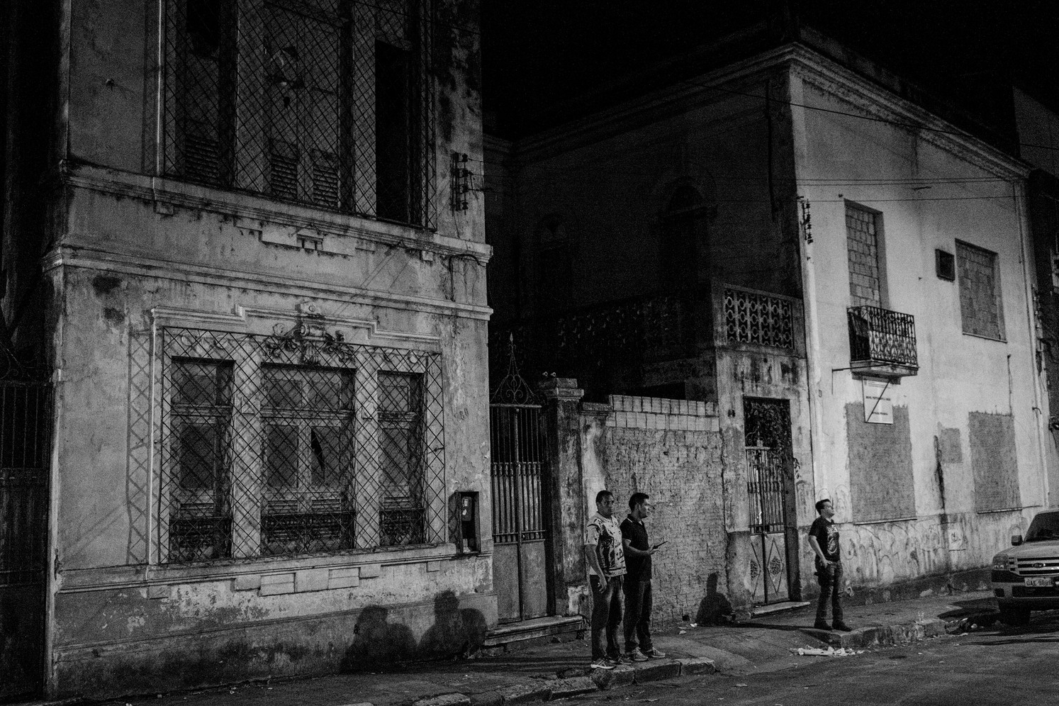 Undercover police agents monitor a street duiring an anti-drug operation in Manaus.
