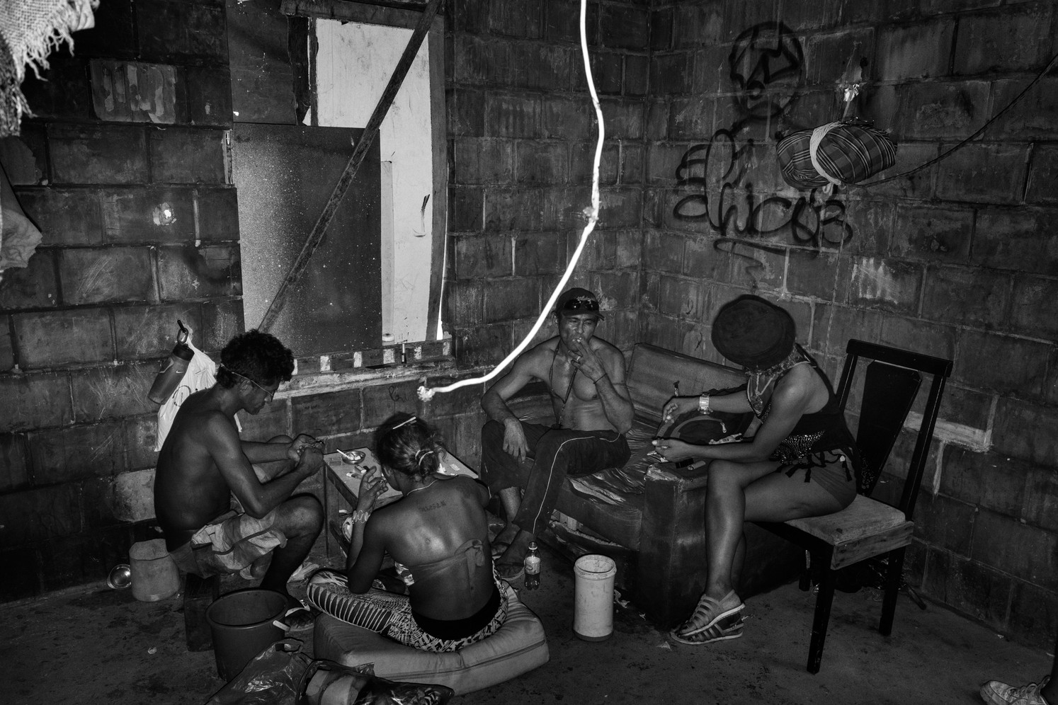 Crack addicts occupy an abandoned public housing lot in Vila da Barca, Belém, the Brazilian Amazon's second biggest city and capital of Pará state. Use of crack and other cheap, smoked cocaine derivatives has exploded in the Amazon states in the last decade. Addicts often stay awake for days at a time smoking. While rocks of crack often sell for as little as US$1, addicts regularly rack up large debts with dealers. Those that don't pay are murdered.