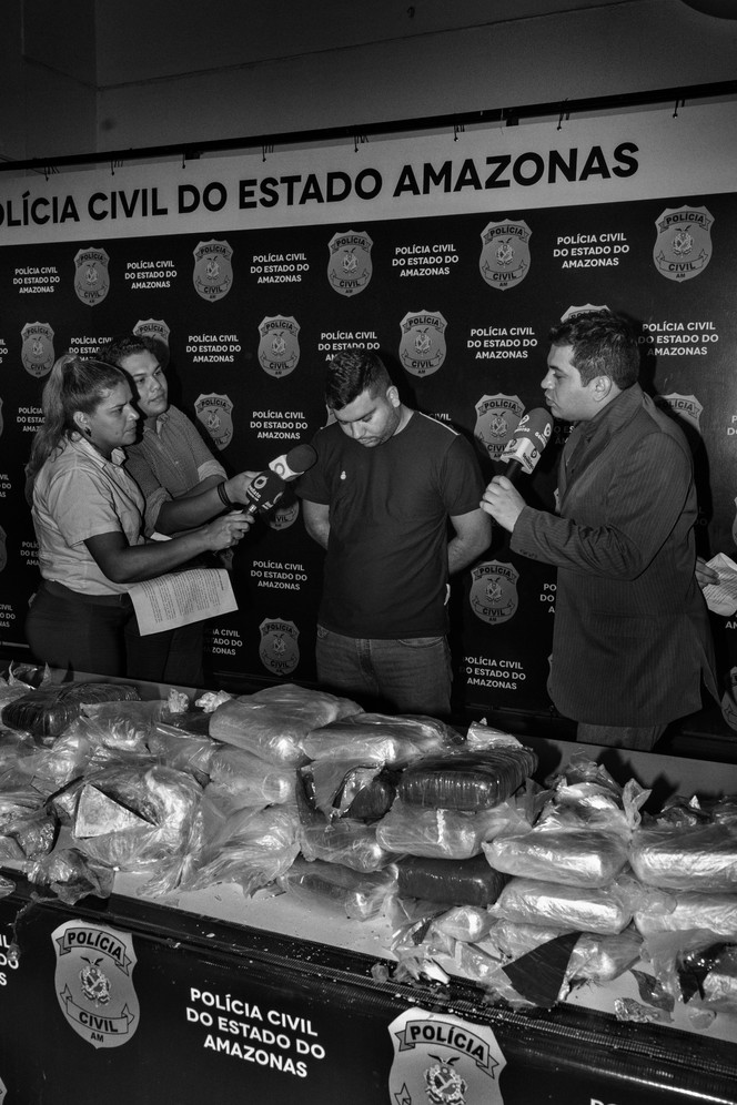 A young man arrested in Manaus transporting nearly 50kg of oxi – a cheap, smoked cocaine derivative similar to crack - ignores questions from reporters. Manaus is the largest and richest Brazilian city close to cocaine producing nations Colombia and Peru. Over the last decade, the Amazon region has emerged as an important domestic and international trafficking route. At the same time, a lucrative local market has flourished.
