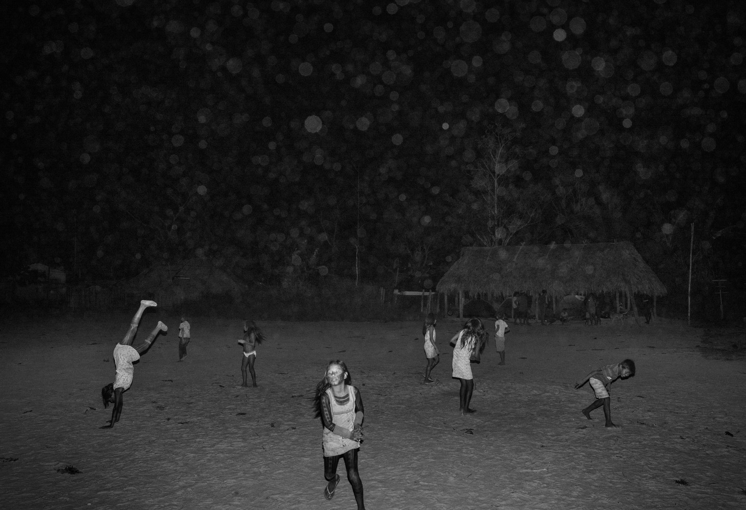 Kayapo indigenous children play at night in the Kubenkrãnken village, southern Pará state. The Kayapo have only been in contact with non-indigenous society since the 1960s. Their land serves as a crucial barrier to deforestation advancing from the south.