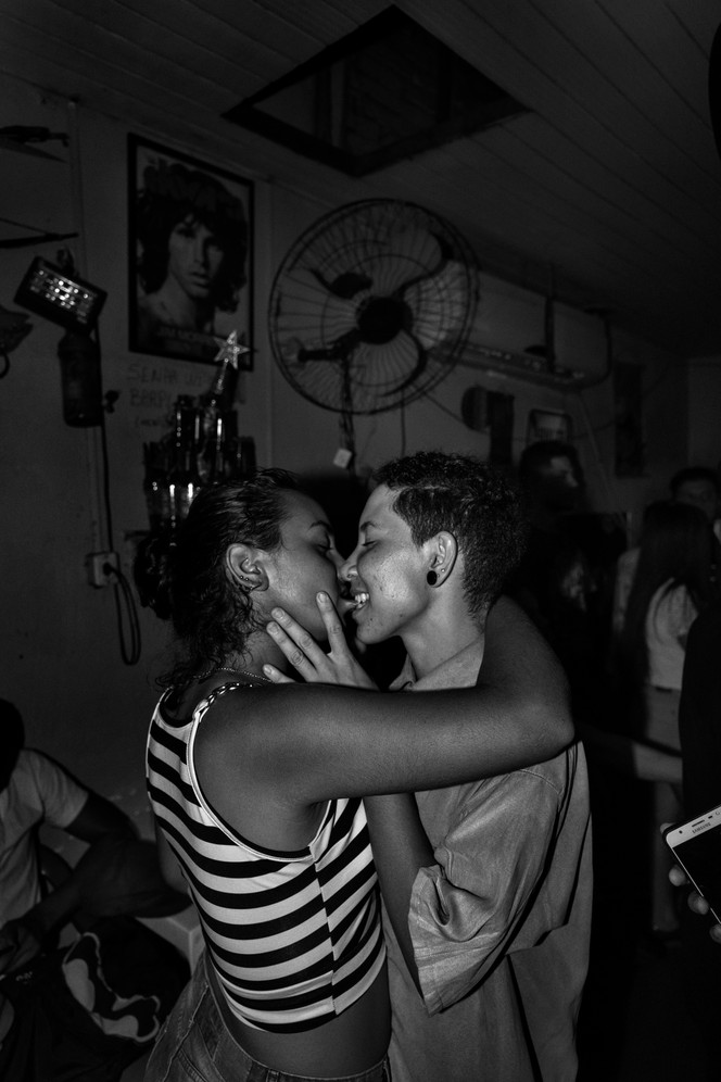 Two young lesbians kiss at an alternative bar in Altamira, Pará state. Brazil hosts the world's largest gay pride parade in São Paulo each year. But it's also a conservative, religious society. Violence against LGBT people is common. Brazil is one of the world's most violent countries. More than 65 thousand people were murdered in 2017.