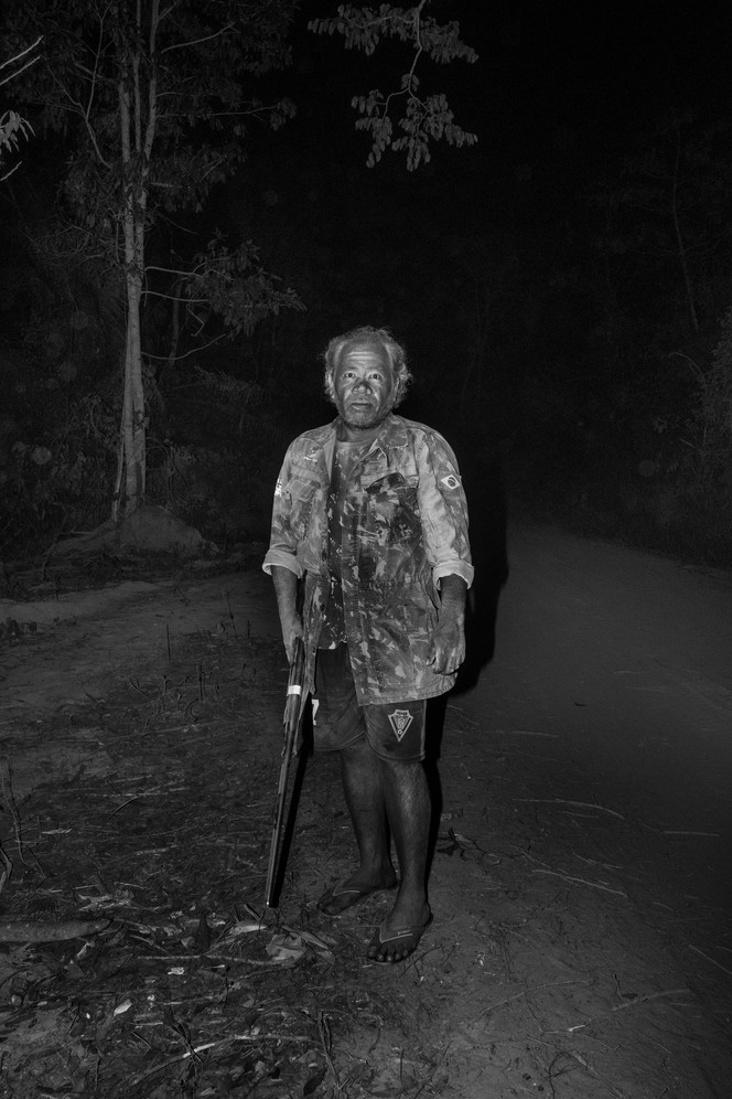 """A """"guardian of the forest"""" tribeman from the Governador indigenous land portrayed during a night patrol. Brazil Indigenous tribes in the lawless east of the Amazon have decided that they can no longer rely on the state to protect them and instead, have formed armed Indigenous militias called """"the guardians of the forest. """"The """"Guardians"""" carry out regular patrols of their territory, expelling loggers. Satellite images show that deforestation has fallen in areas that they are most active."""
