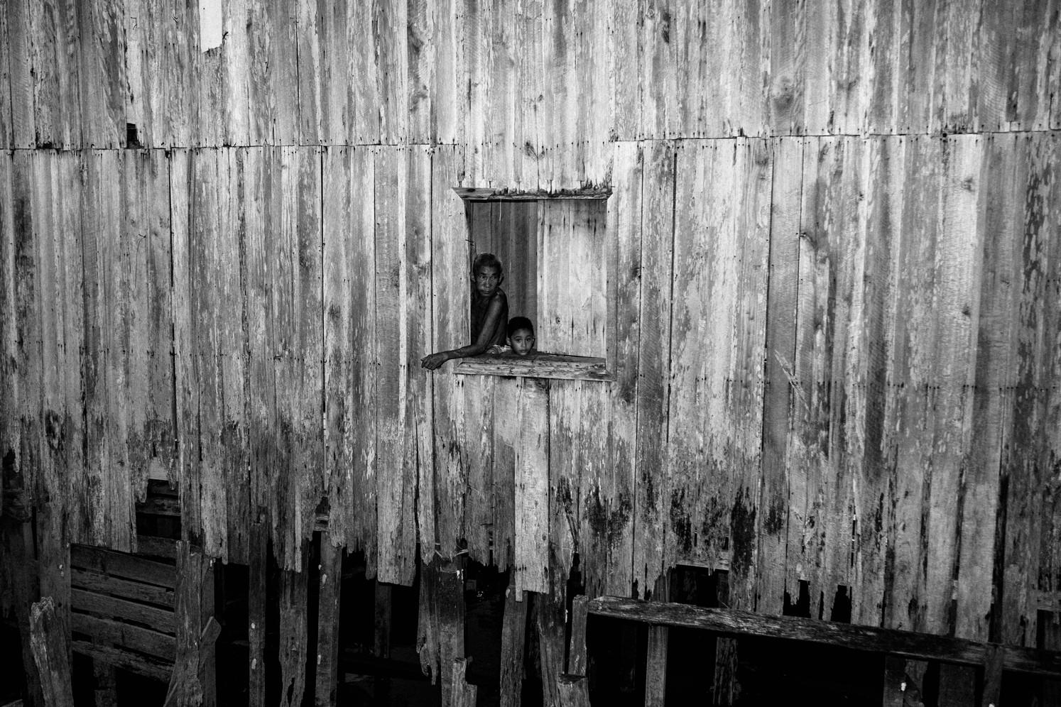 Residents in the Vila da Barca, a poor neighborhood of stilt houses in Belem.