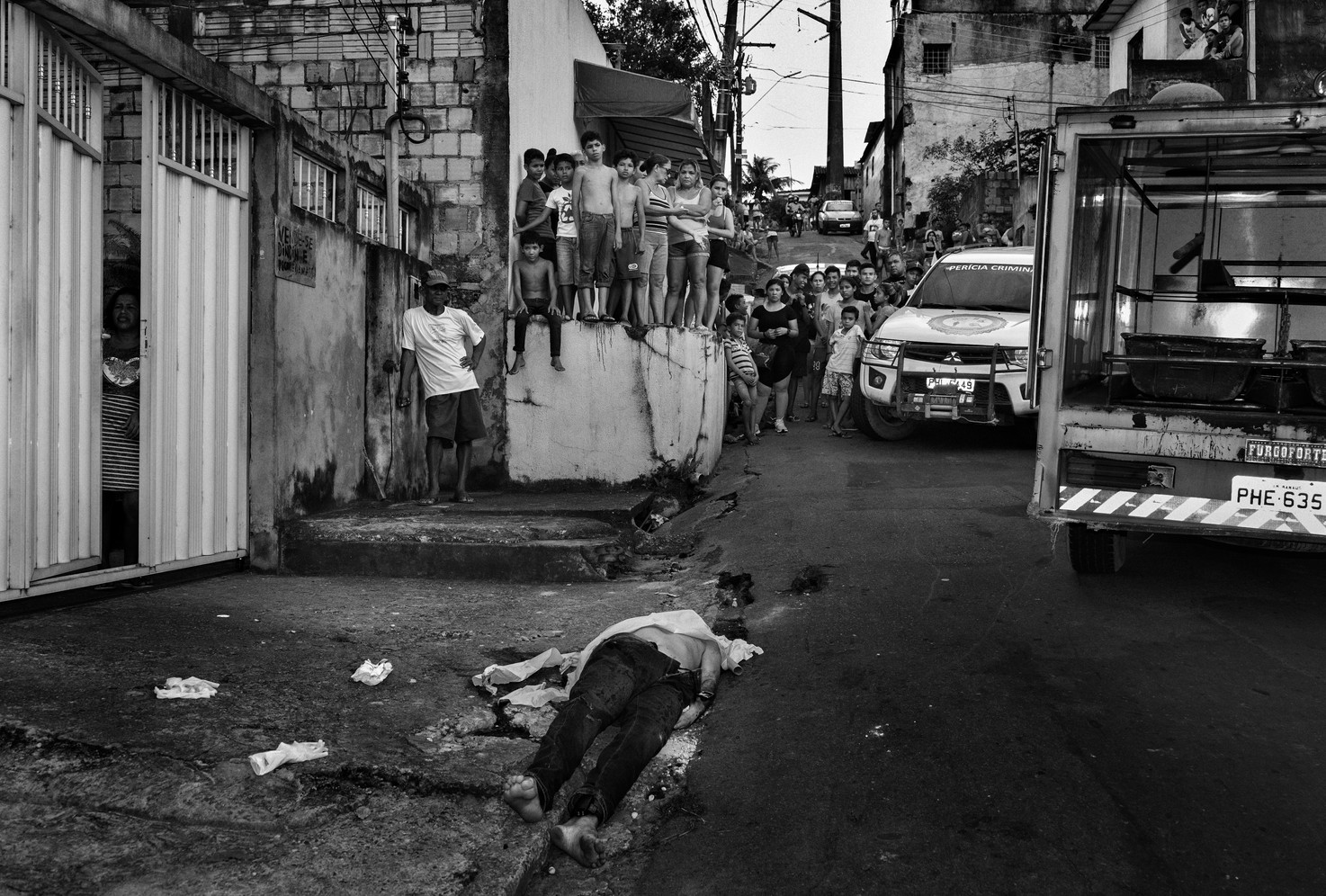 Homicide victim in Manaus, who had recently been released from jail, wears an electronic ankle tag. He was shot close to his home. With a population of just over two million, the city regularly has upwards of five murders a day. According to local security officials, the majority of murders in the city are connected to the drug trade. Victims are overwhelmingly young men of colour with little schooling from poor neighbourhoods killed with small firearms sold on the local black-market.