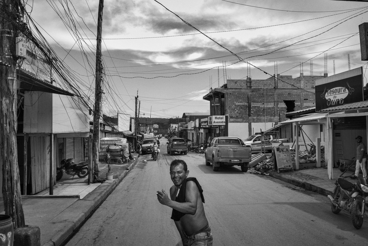 A garimpeiro – wildcat miner - stands drunk in the streets of Crepurizão, a gold mining town in southwestern Pará state. The town serves as a base for miners stay and to take small planes to a number of illegal goldmining sites in the region, including on indigenous lands and protected forest areas. The town's entire economy revolves around illegal gold extraction