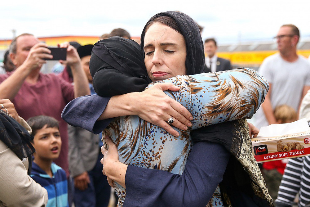 New Zealand Prime Minister Jacinda Arden embraces victims of the terrorist attacks.