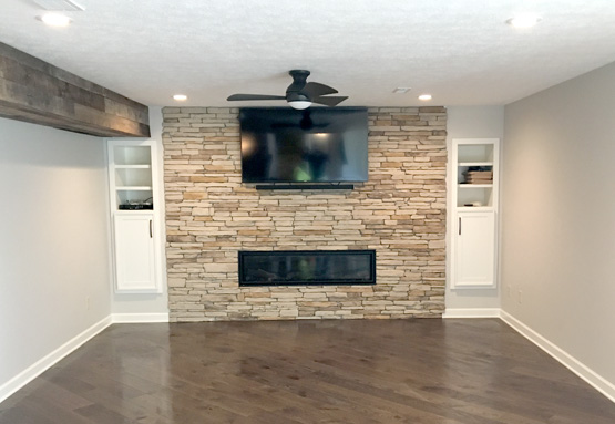 Tan Brick Fireplace with TV