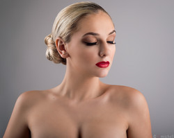 Blond model with hair bun and makeup
