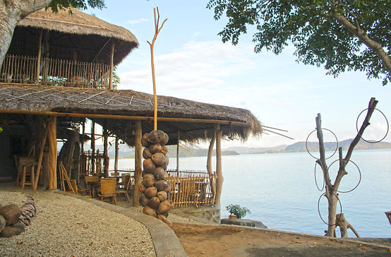 The seaside bar and restaurant of Hula Hoop Bungalows on the Beach on Gili Gede Island, Lombok, Indonesia