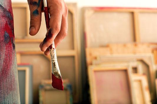 Holding a Paintbrush_edited_edited.jpg