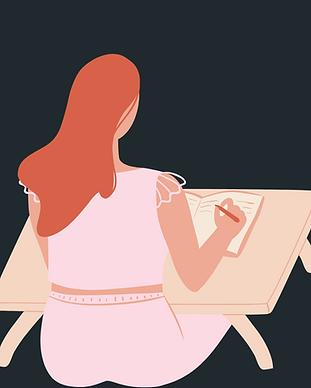 Woman journaling on a desk