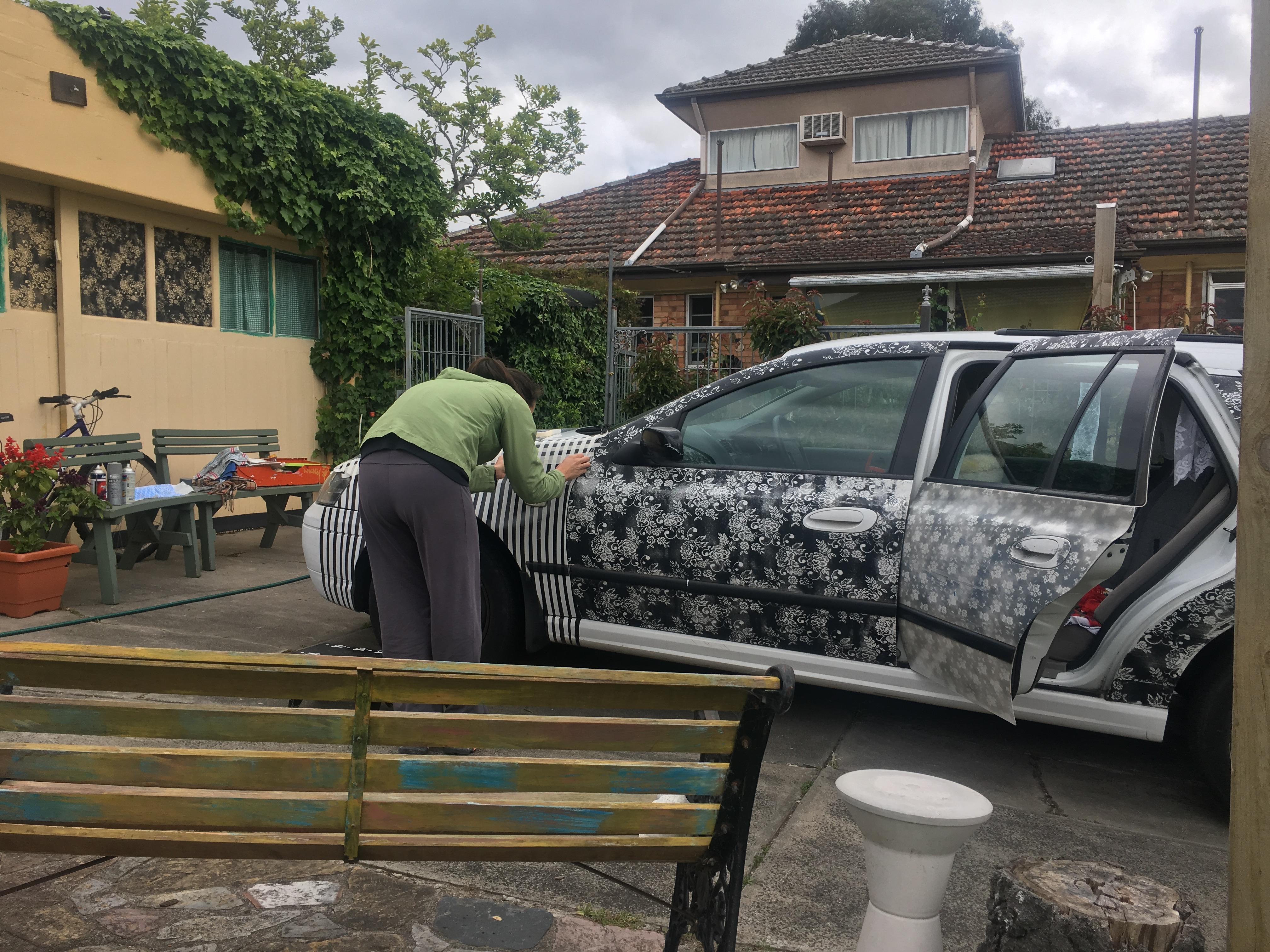2018. Sandra helping spray the car