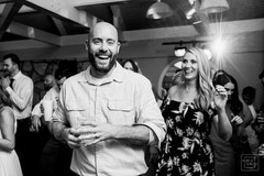 wedding guest laughs while on dance floor
