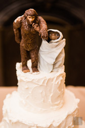 The coolest wedding cake topper you will ever see at a wedding. ET and Sasquash wedding cake topper