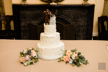 wedding cake with ET and sasquash topper on it