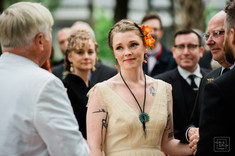bride looks at her new father inlaw durring New Orleans wedding ceremony