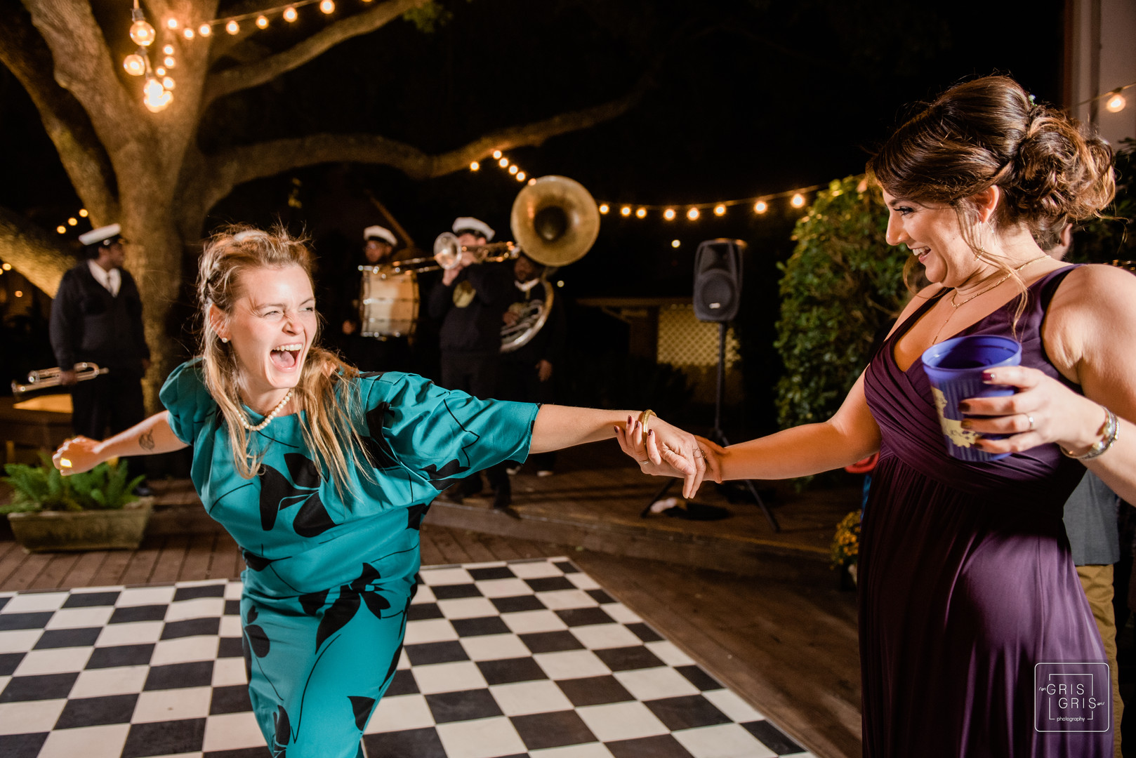 wedding guest dance to jazz music durring reception at compass point events