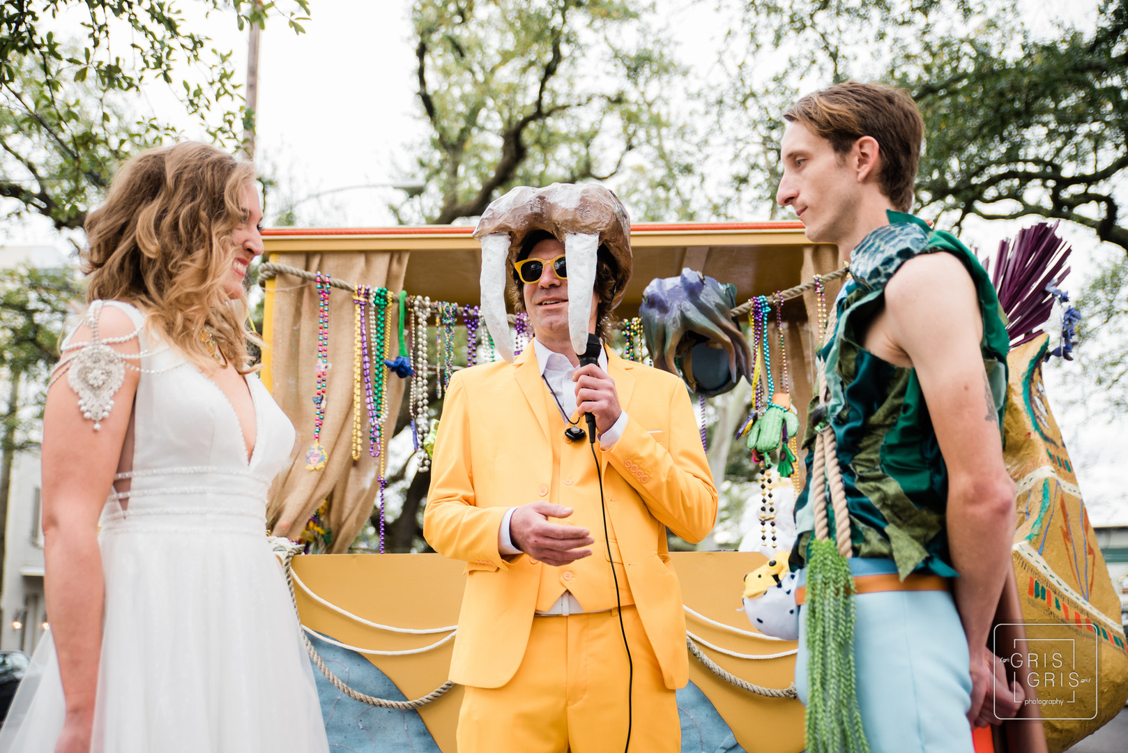 bride and groom get married in the french quarter on mardi gras day