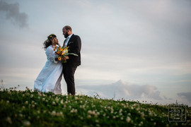bride and groom look into each others eyes on top on new orleans levee