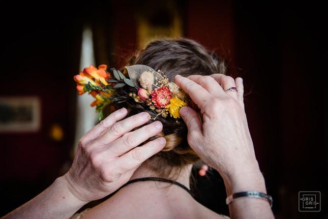 Brides maids helps fix flowers in brides hair