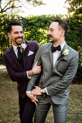 same sex couple poses for cute wedding pics