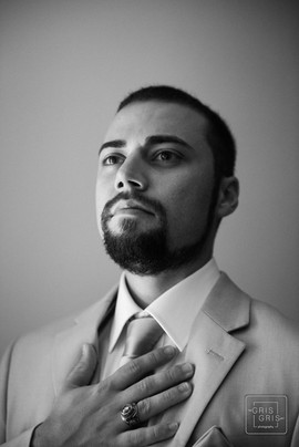 Groom poses for a portrait using window light