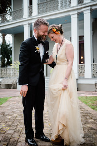 husband and wife laugh durring portrait session at new orleans wedding
