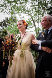 father looks at his daughter as he walks her down the aisle at this nola wedding