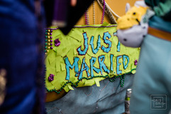 Just maried sign durring a mardi gras day wedding