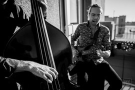 musician plays string bass guitar durring wedding ceremony at new orleans lakefront airport