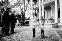 black and white photo of girls walking down aisle in nola wedding