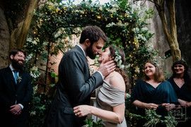 first kiss durring wedding ceremony at New Orleans Pharmacy Musuem