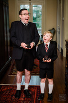 ring bearers pose with their moths open while holding rings