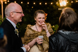 bride laughs with her guests