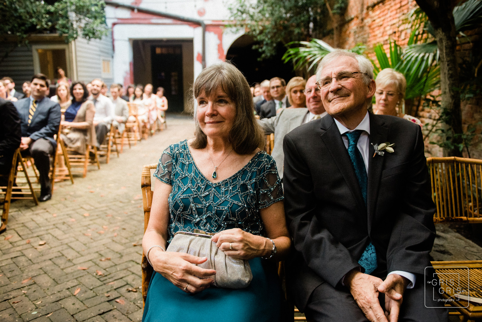 mother and father of the bride watch their daughter get married at the new orleans pharmacy museum