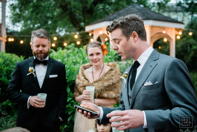 best man reads from phone for speach made