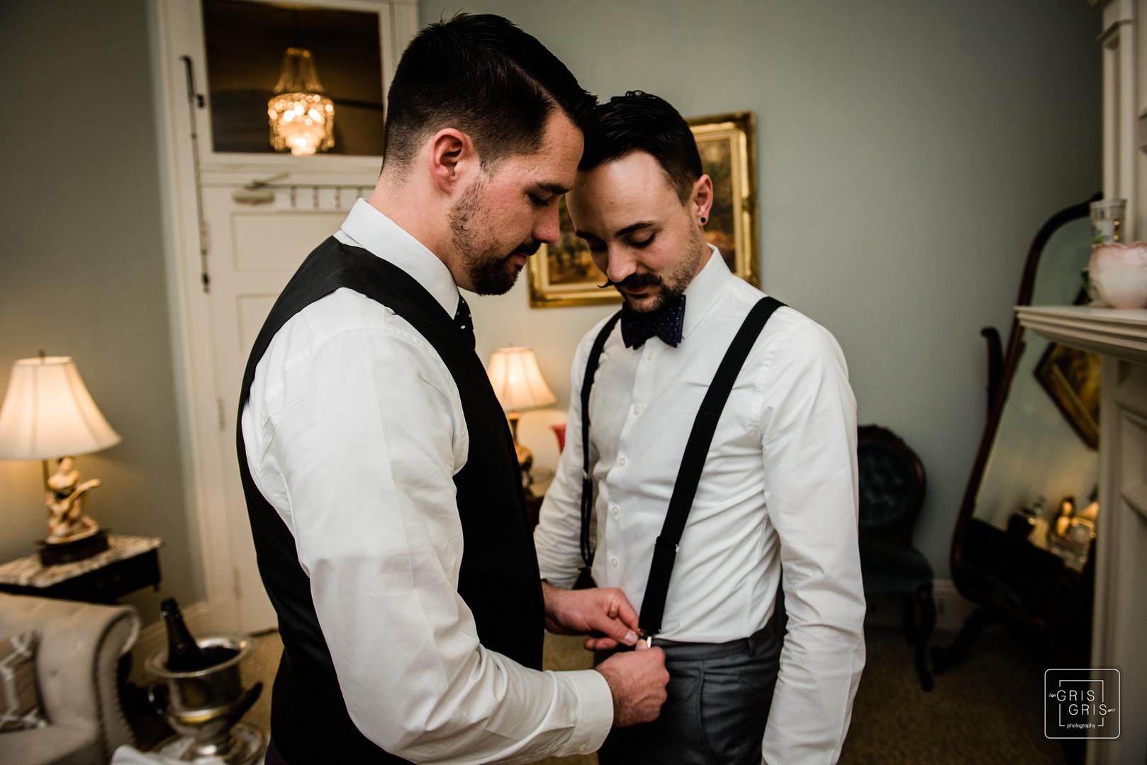 groom helps is groom get ready durring pre ceremony prep