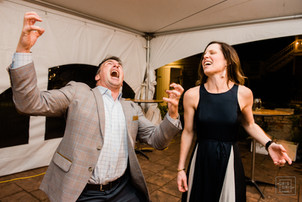 wedding guest dancing and yell lyrics to song in backyard wedding reception tent