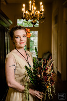 Bride poses for bridal portrait while holding floral bouqet