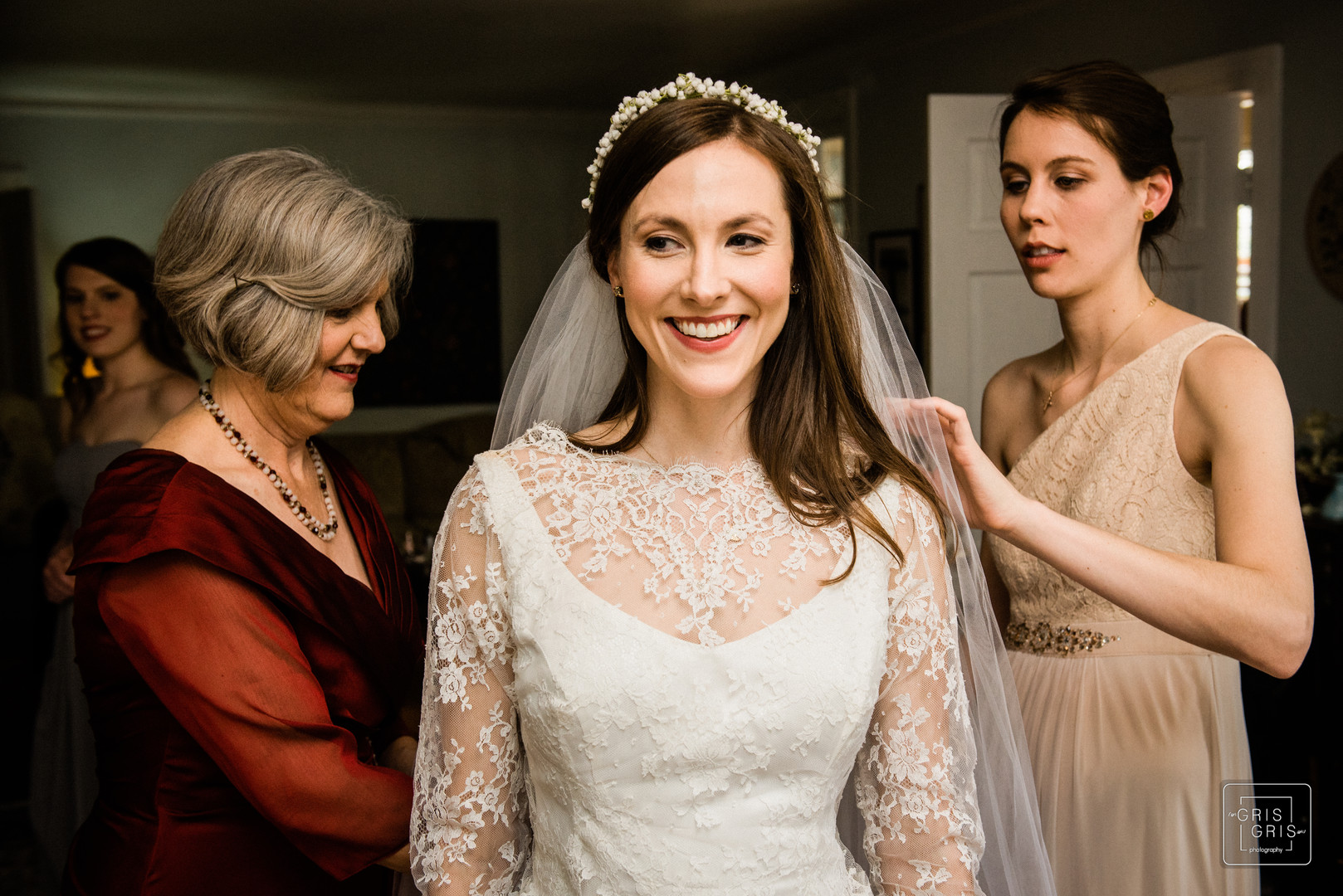 mother and bridesmaid helps put on veil in there new orleans uptown family home