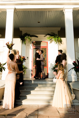 groom and grooms first kiss at the new orleans benachi house